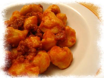 gnocchi di zucca con ragù di salsiccia