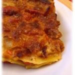 Lasagna con pesto e pomodorini al caprino